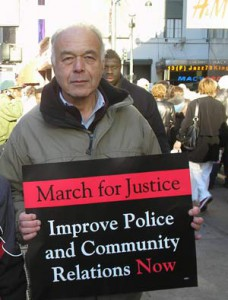 Photo of Steve Max with placard for March for Justice