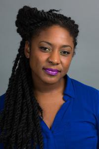 Publicity photo portrait of Alicia Garza with dreads
