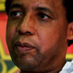 Photo portrait of Chris Hani, closeup, 3/4 head looking serious to the right