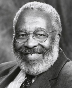Portrait photo of Dr. Vincent Harding, smiling, with wire rim glasses and full grey beard