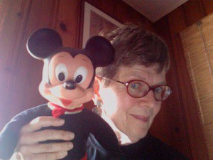 Mickey Ellinger holding Mickey Mouse head
