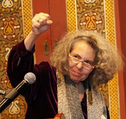 Kaye/Kantrowicz with fist raised at podium being honored at JFREJ 2012