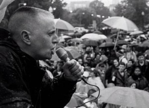 Leslie Feinberg speaking at rally.